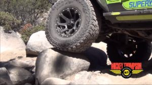 Wrangler Jeep with ATZ P3 tires climbing rocks